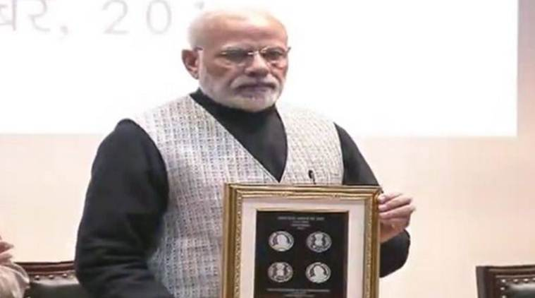 pm-modi-releases-rs-100-commemorative-coin-in-memory-of